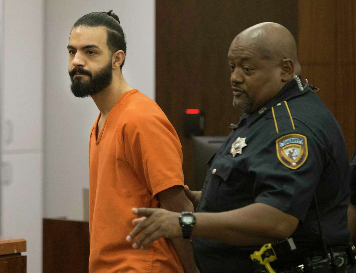 Nasim Irsan is taken away after pleading guilty to a murder charge for firing the shot that killed Gelareh Bagherzadeh, 30, at the urging of his father and mother on Thursday, Aug. 29, 2019, in Houston. Irsan was sentenced 40 years in prison and will be eligible for parole after serving 20 years. Irsan's father, Ali Irsan, was sentenced to death for two grisly