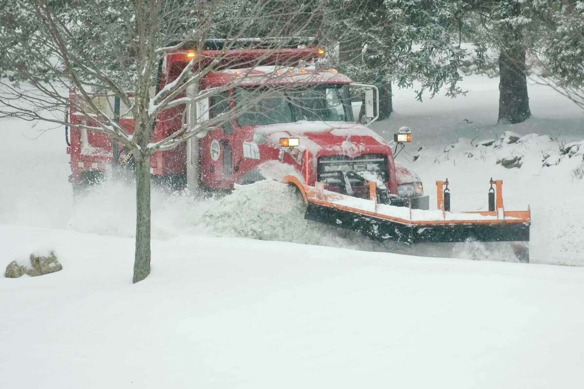A Ridgefield town truck clears Bennetts Farm Road of snow and ice. Sunday, Feb. 12, 2017