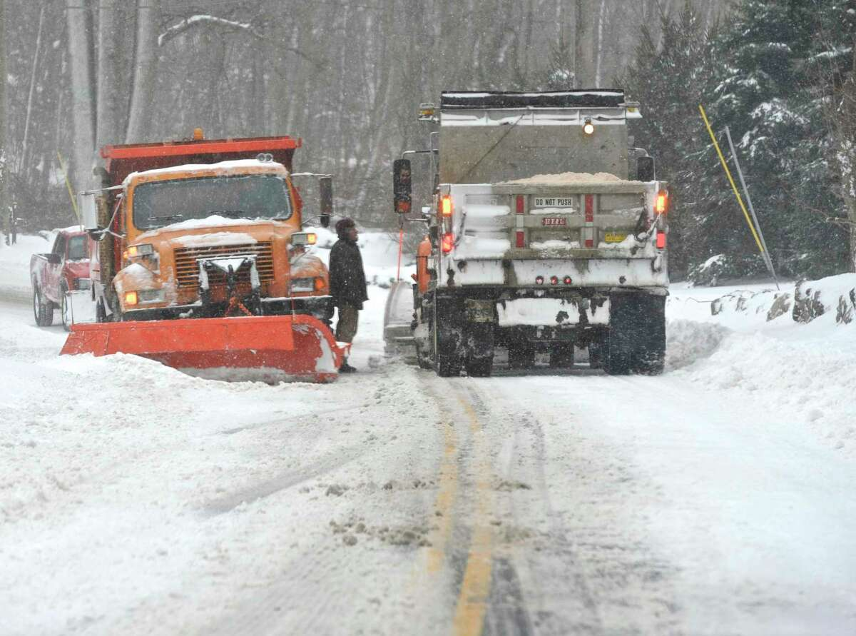 Two snowplow drivers stop to talk on North Salem Road in Ridgefield, Conn, during Thursday's snowstorm, February 9, 2017.
