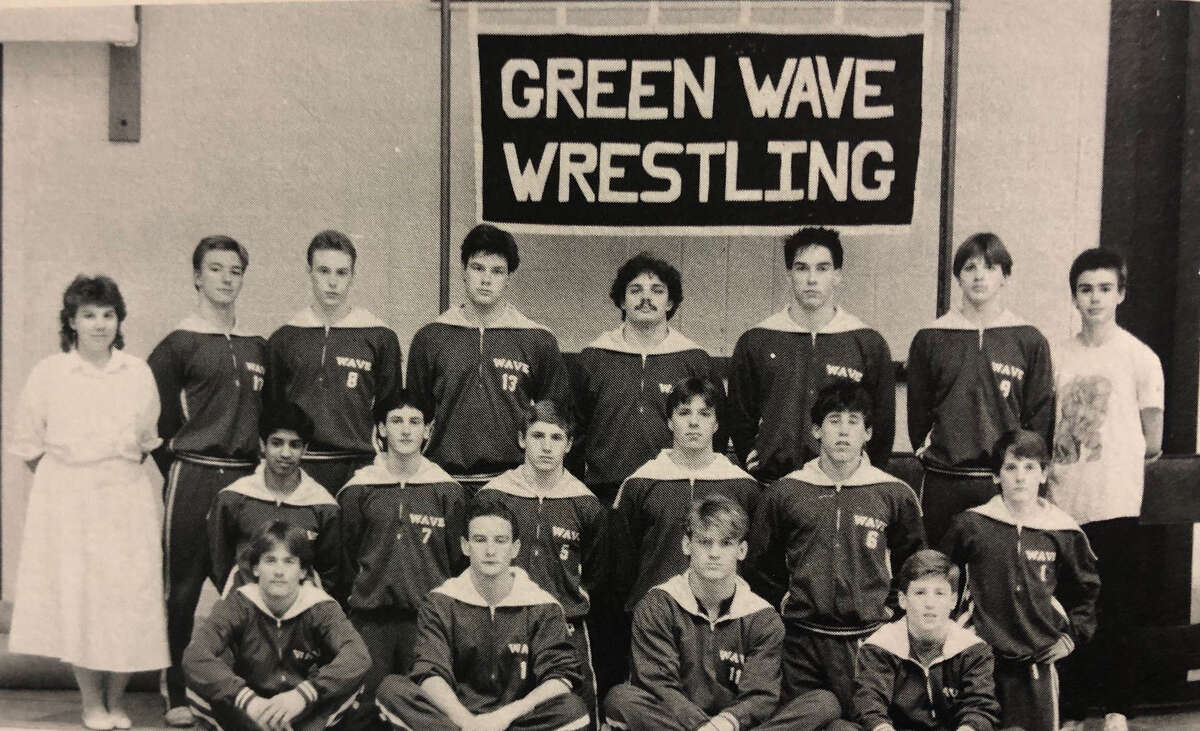 Spectrum/The New Milford High School wrestling team for the academic year 1986-87 had an incredible season, boasting an undefeated record in the WCC's. The boys were WCC Champs for the second year in a row. Mike Morris, Brian Roberts, Tom Schillaswki and Steve Colville were individual champions. New Milford wrestlers also faired well in the State meet, finishing second as a team. Dave Cooper was named State Champ in his weight division. Above are, from left to right, captains Steve Colville, Mike Morris, Dave Cooper and Dave Cherniske; second row, Vinaya Reddy, Jeff Warde, Tom Schillawski, Craig Iaia, Jared Vairengo and Brian Roberts; and in back, Manager C. Schillawski, E. Mantion, Kevin Sullivan, Jonathon Saul, Robert Gaylor, S. Castle, John Callaghan and Manager Michael Crawford. If you have a