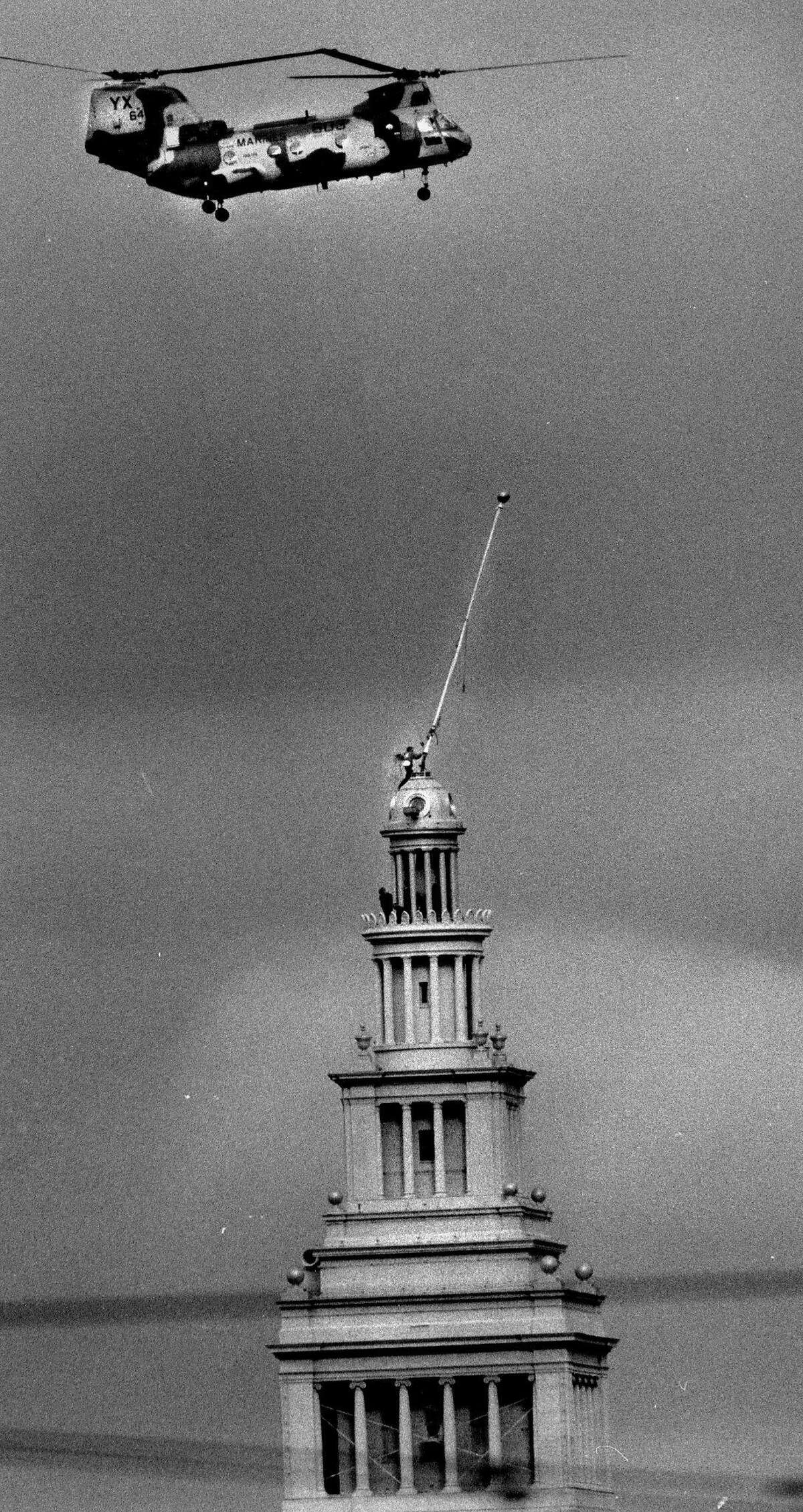 Reparing the Ferry Building flag pole, damaged by the Loma Prieta earthquake No run date Photo shot 10/1989