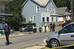 Schenectady police investigate a shooting on Vassar Street that left a man with a gunshot wound to the stomach Thursday afternoon.
