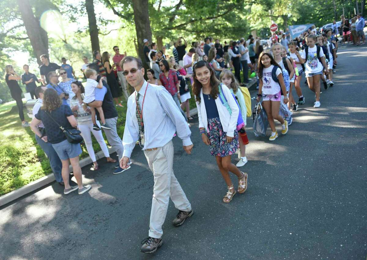 Photos from the Parade of Learners on the first day of school at Riverside School in the Riverside section of Greenwich, Conn. Thursday, Aug. 29, 2019. What will the first day of school look like in 2020?