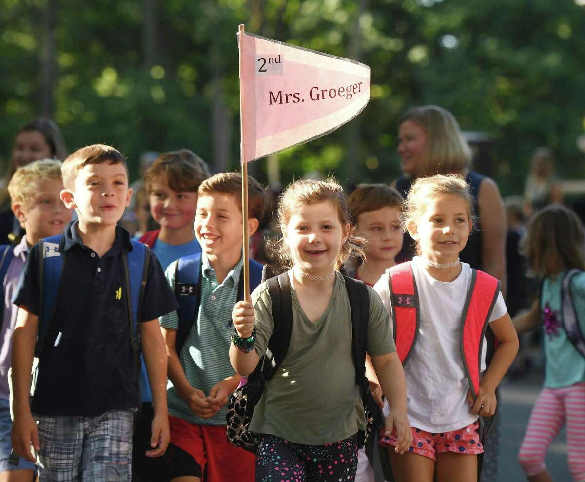 Photos from the Parade of Learners on the first day of school at Riverside School in the Riverside section of Greenwich, Conn. Thursday, Aug. 29, 2019.