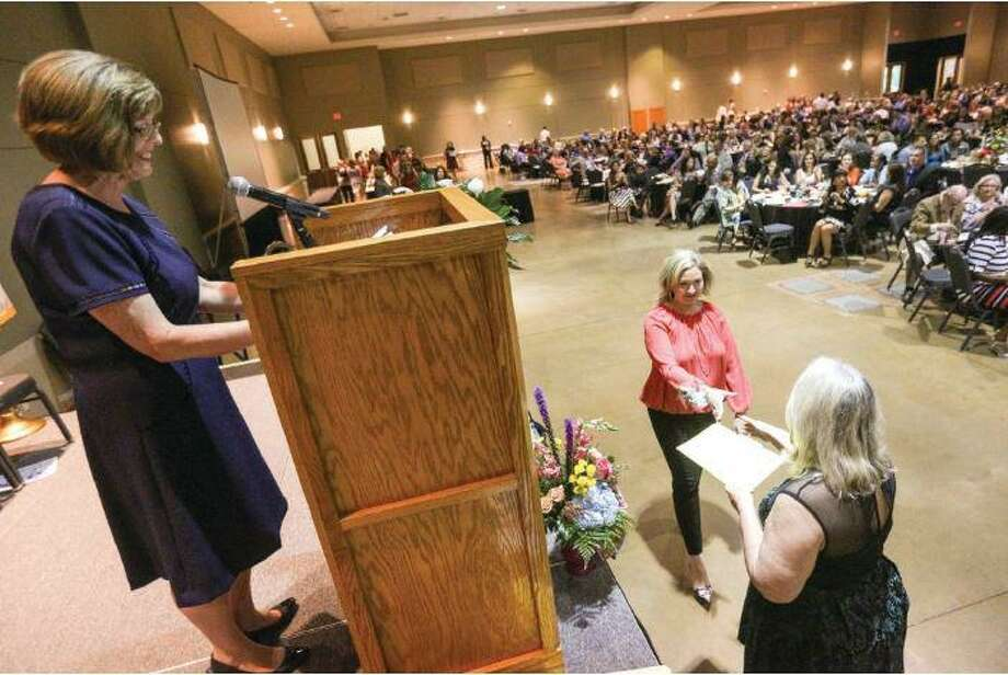Teachers and staff cheer on their honorees during a previous year's Texas State Teacher's Association-Conroe / Conroe ISD Salute to Education Banquet at the Lone Star Convention Center. TSTA-Conroe has about 450 members from Conroe ISD. Photo: File Photo / File Photo