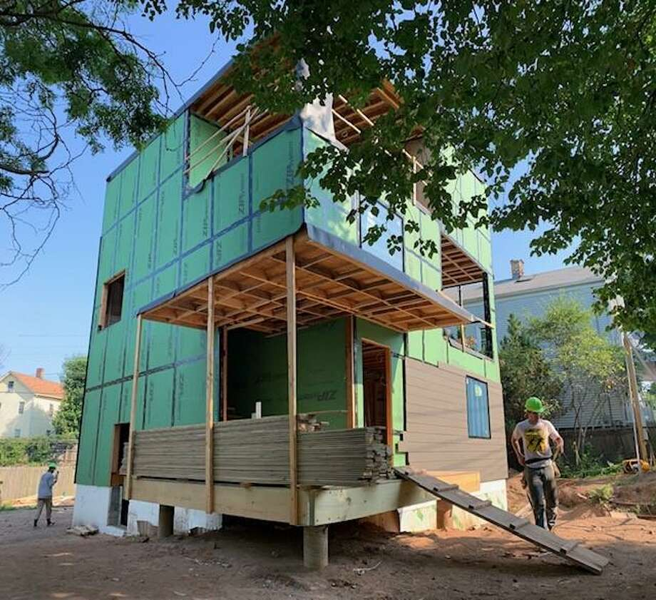 A triplex nearing completion on Plymouth Street in New Haven,  designed and being built by first-year students at the Yale School of Archtecture as part of the Jim Vlock Building Project. Photo: Contributed Photo