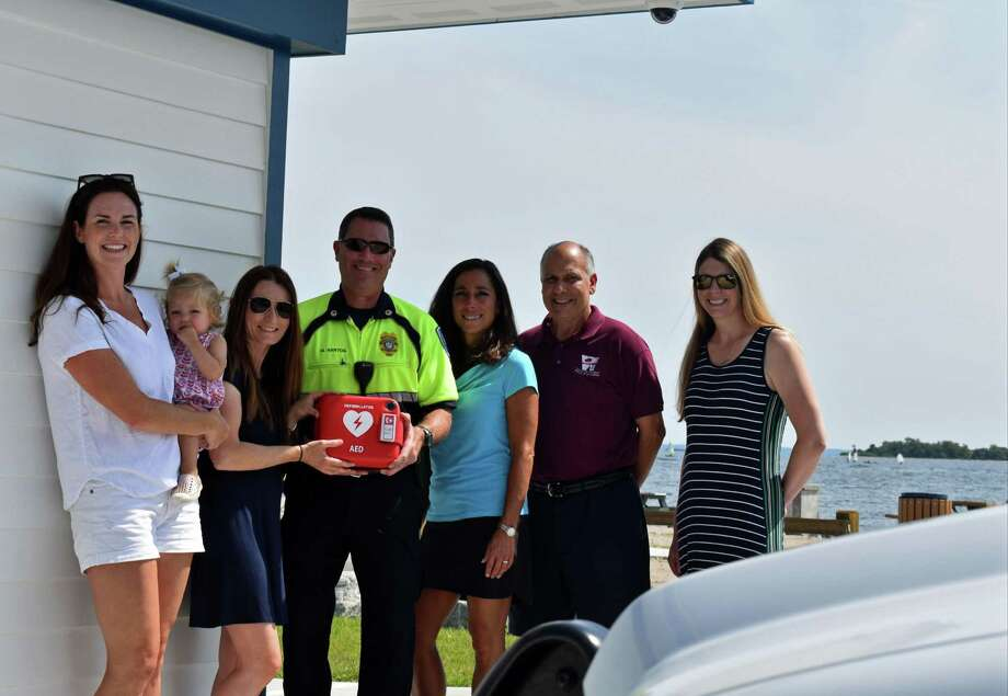 From left ,Kings Highway Elementary School teacher Kate Romano, Assistant Principal Tracey Carbone, Westport Parks & Recreation Director Jennifer Fava, Parks & Recreation Deputy Director, and teacher Tara Doyle recently presented an automated external defibrillator to Westport EMS Deputy Director Marc Hartog, center. Photo: Contributed