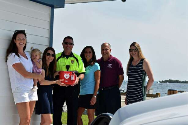From left ,Kings Highway Elementary School teacher Kate Romano, Assistant Principal Tracey Carbone, Westport Parks & Recreation Director Jennifer Fava, Parks & Recreation Deputy Director, and teacher Tara Doyle recently presented an automated external defibrillator to Westport EMS Deputy Director Marc Hartog, center.