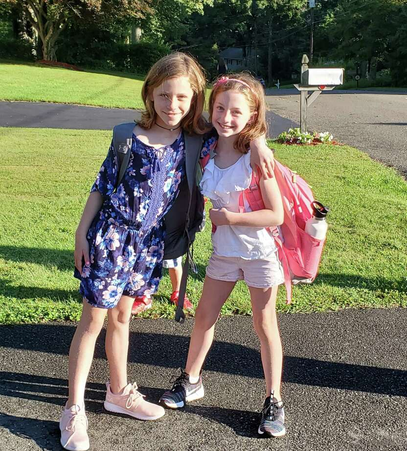 Claire Targowski Anna Broas wait for the bus to Tashua Elementary. Photo: Contributed / / Trumbull Times Contributed