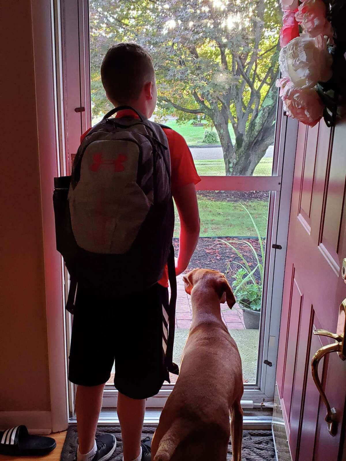 Scotty Targowski and his buddy Emmy wait for the bus to Madison Middle School.