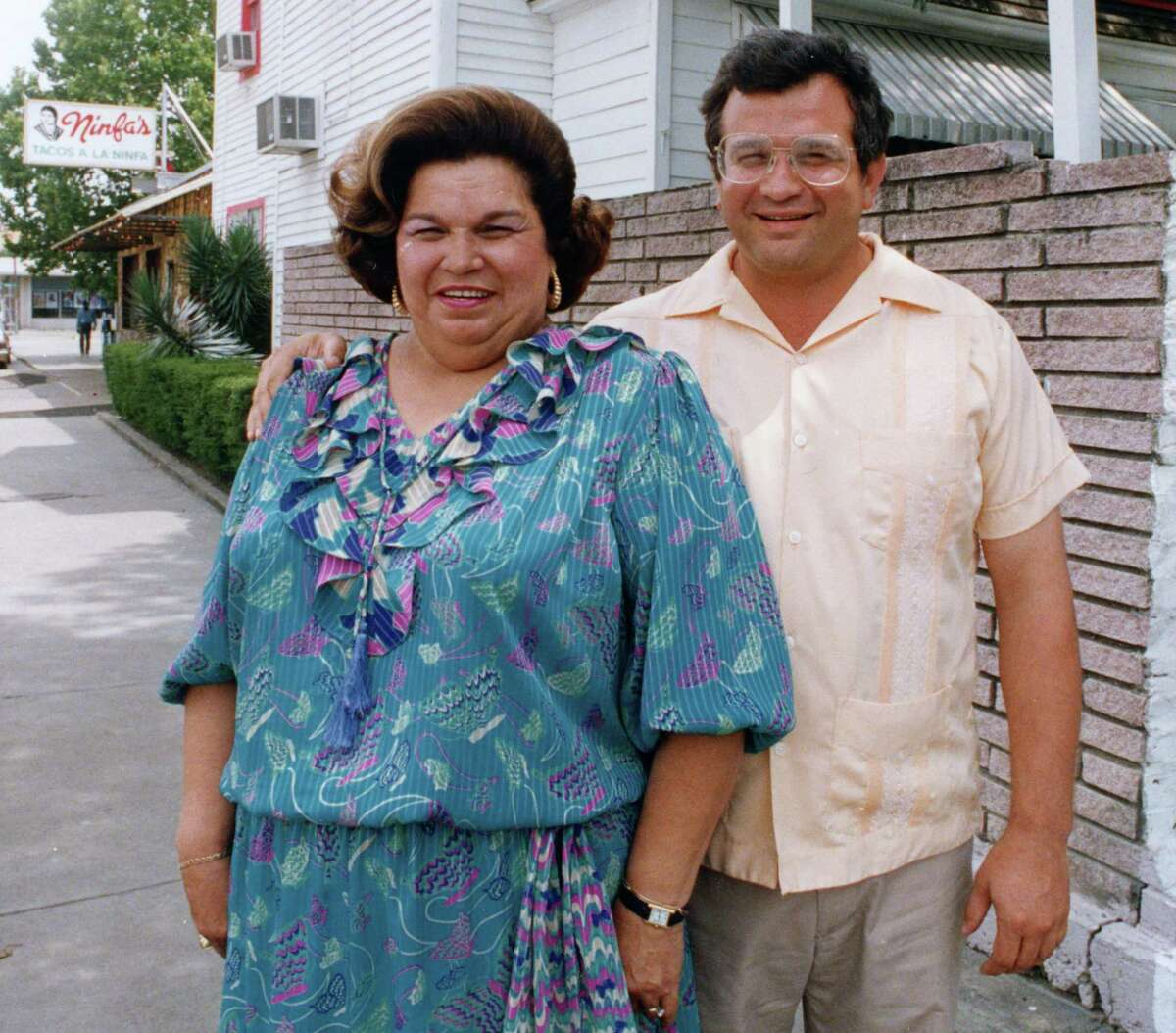 06/21/1988 - Ninfa Laurenzo and her son Roland Laurenzo, operators of Ninfa's Mexican restaurant chain, stand outside the old Laurenzo family home, now the office of Bambolino's, the family's new drive-through pizza venture. Next door is the original Ninfa's restaurant at 2704 Navigation.