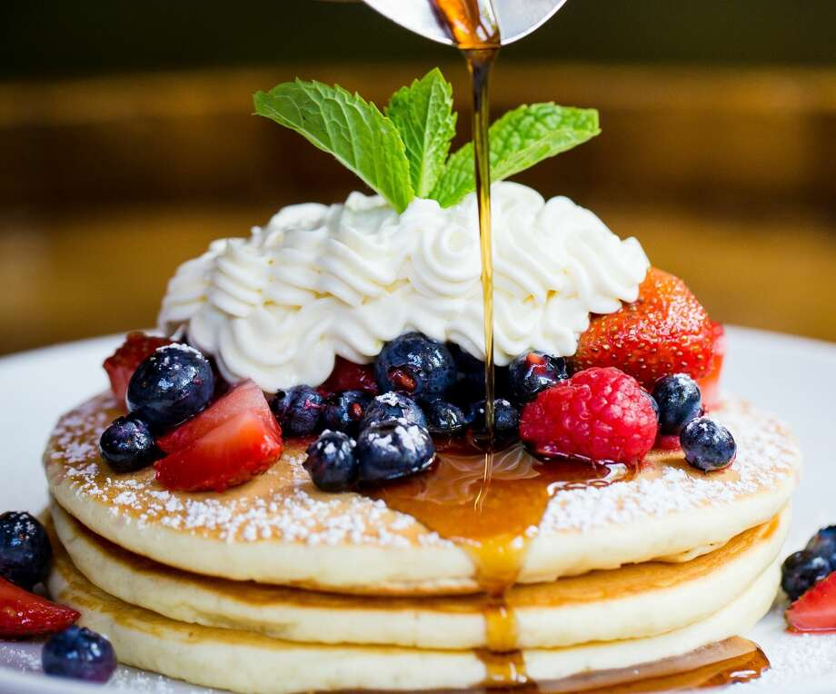 Radunare Italian-American Table Where: 2520 Research Forest, The Woodlands When: Saturday and Sunday; 7 a.m. to 2 p.m.At brunch, this casual Italian restaurant in The Woodlands offers mains from ricotta and berry pancakes (pictured) to a panini with scrambled eggs, cheddar and pancetta to the Italian Breakfast with two eggs, polenta, Italian sausage and caponata, a Sicilian eggplant dish. Photo: Becca Wright