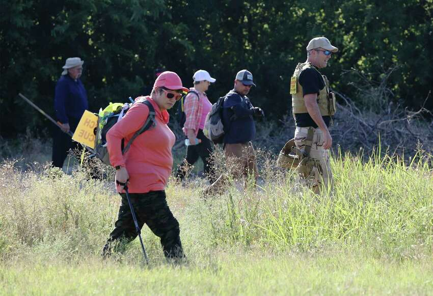 A line of searchers with Search & Support San Antonio comb a field as they look for Cecilia Huerta Gallegos on July 27, 2019. Gallegos, 30, is the mother of four. Her husband, Reyes Gallegos, 34, was arrested Aug. 28, 2019, for filing a false police report, accusing his wife of assaulting him.