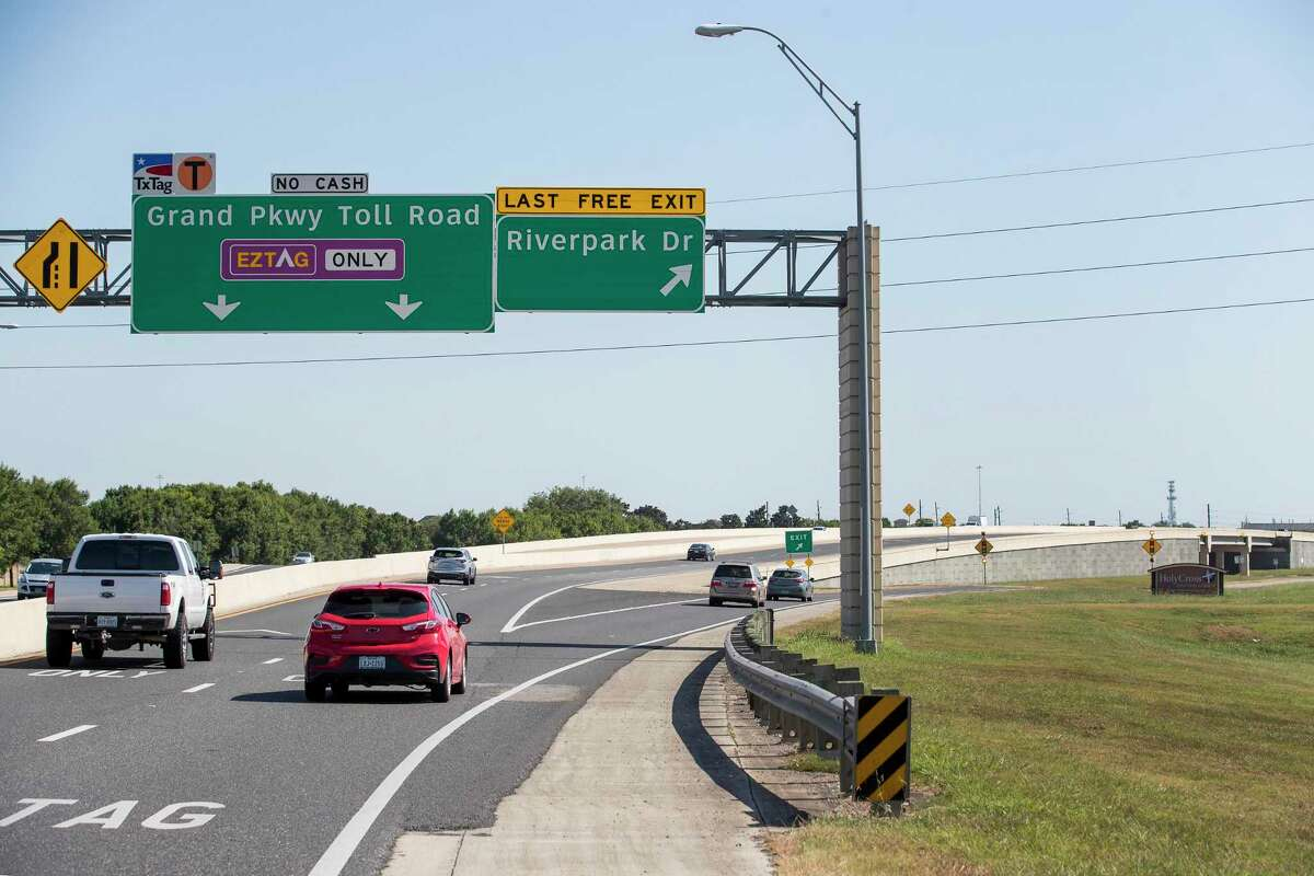 Vehicles drive southbound toward the exit off the Grand Parkway near Interstate 69 on July 24, 2019, in Sugar Land.