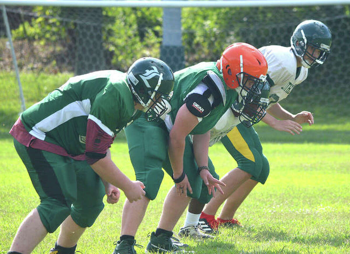 The offensive line performs drills during Metro-East Lutheran football practice last week.