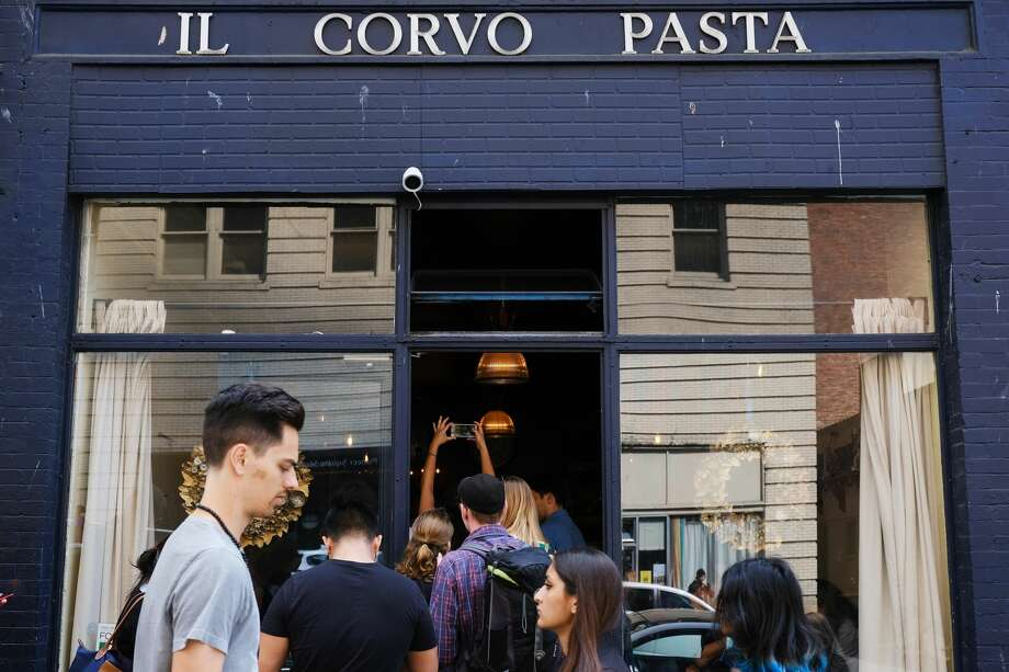 The line at Il Corvo Pasta winds out the door and down the block as people wait to order the pasta of the day. The weekday lunchtime line took about 35 minutes of wait time.  (Genna Martin, Seattlepi.com) Photo: Genna Martin/seattlepi.com