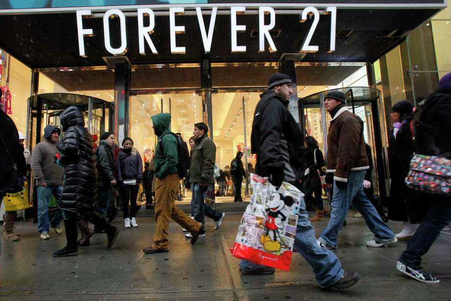 People walk past a Forever 21 store in New York's Times Square, Sunday, Dec. 26, 2010. (AP Photo/Mary Altaffer) Photo: Mary Altaffer / AP / AP