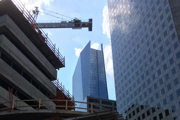 The Texas Tower office building is under construction in downtown Houston on Texas Avenue between Travis and Milam.