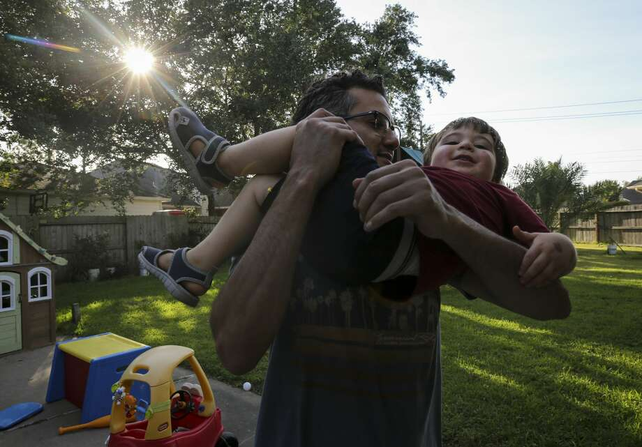 "Shoja Zaidan plays with his nephew, Elias, in the backyard of his parents' home. ""I think everything made us stronger because it made us realize no matter what, we're still together,"" said Shoja. ""We're still family."" Photo: Godofredo A. Vásquez/Staff Photographer"