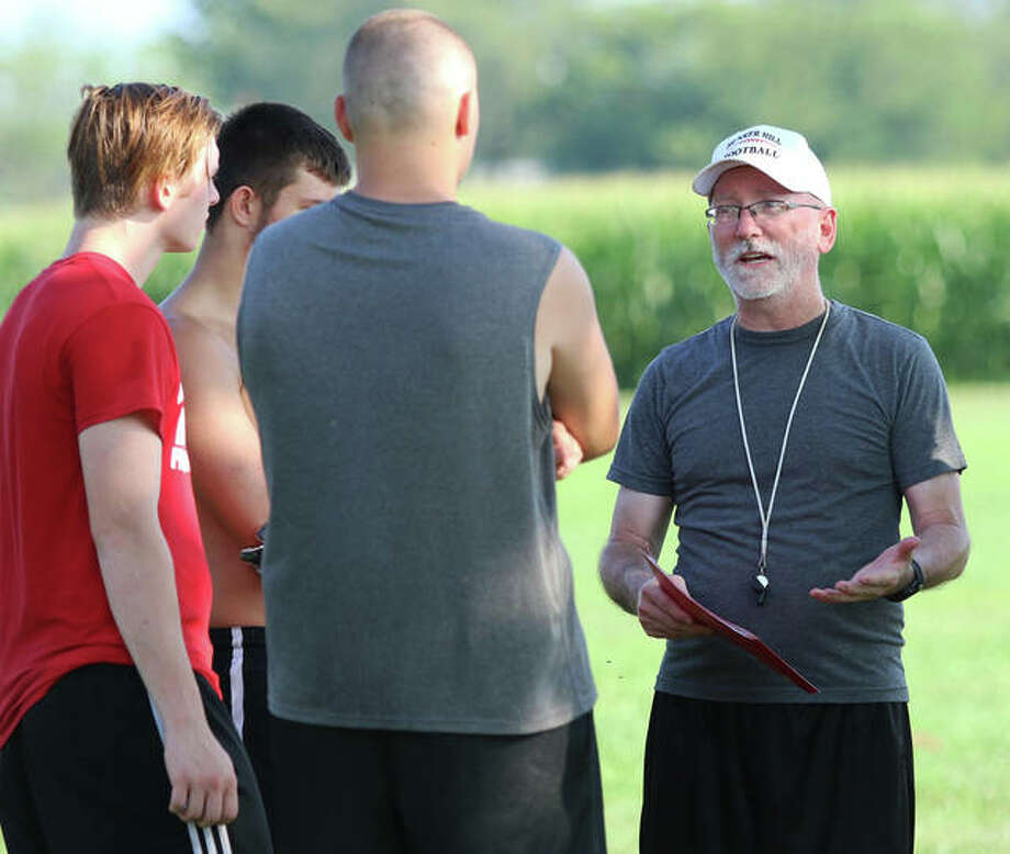 First-year Bunker Hill coach Michael Burke (right) talks with some linemen during the first practice of the season on Aug. 12 in Bunker Hill. The Minutemen will play eight-man football for the first time in 2019. Photo: Greg Shashack / The Telegraph