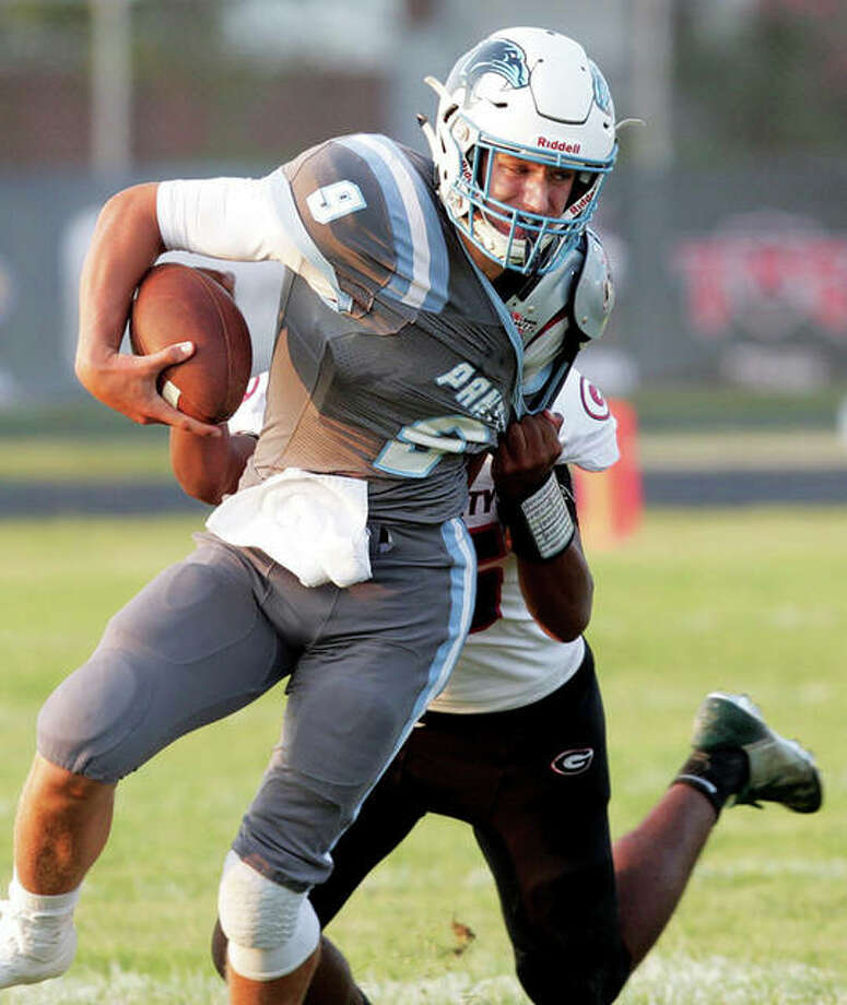 Jersey quarterback Matthew Jackson fights for yardage against Granite City. Photo: James B. Ritter File | For The Telegraph