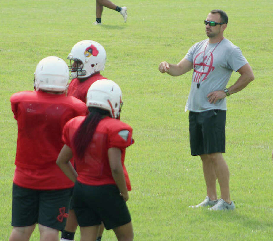 Alton head coach Eric Dickerson, right, gives instructions during a practice at AHS. Photo: Pete Hayes | The Telegraph
