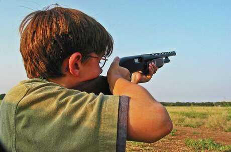 A young hunter takes aim in the Central Zone, where conditions are ripe for plenty of whitewing and mourning doves on the opening day on Sunday.
