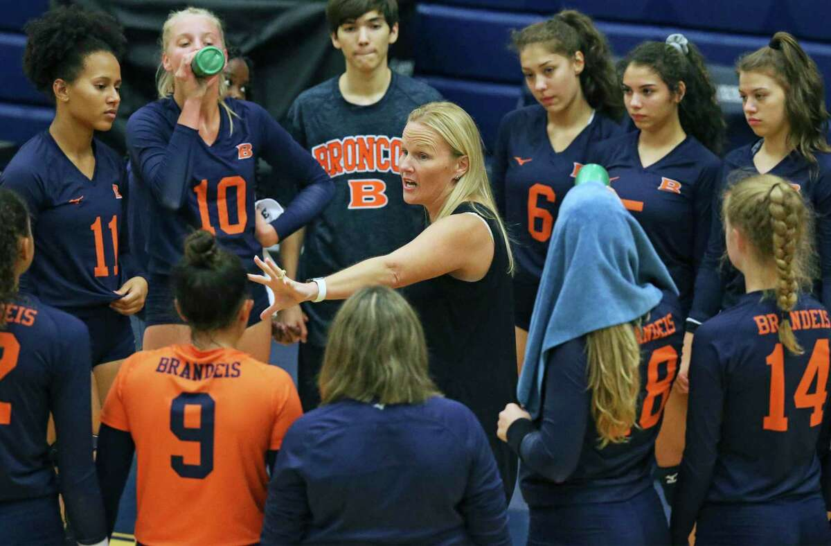 Bronco coach Madeline Williams talks to the team as Brandeis plays Alamo Heights at Taylor Field House on August 120, 2019.