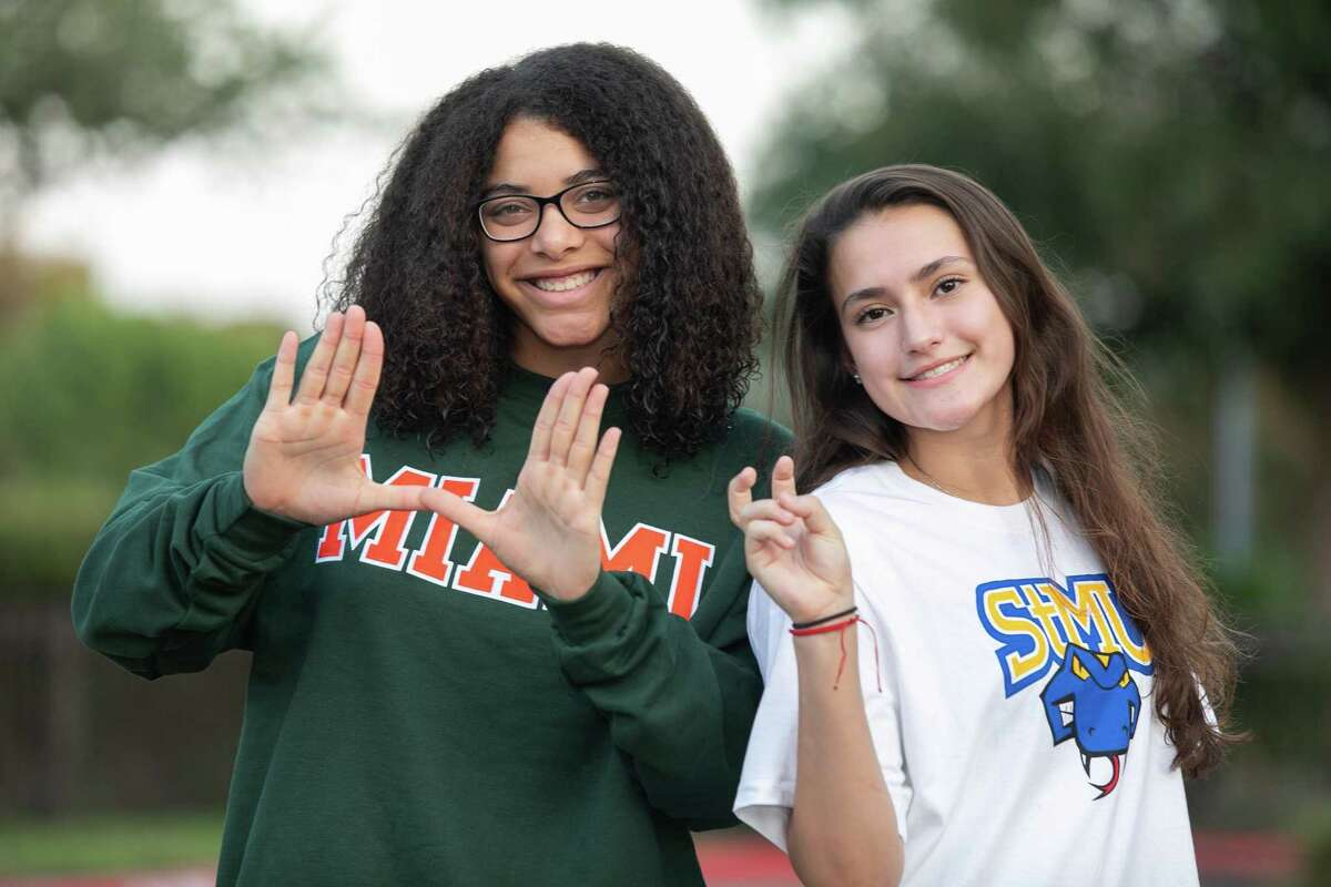 Reagan volleyball players Nyah Anderson (left) committed to Miami and Julia Aleman pledged to St. Mary's. Both are junior outside hitters.