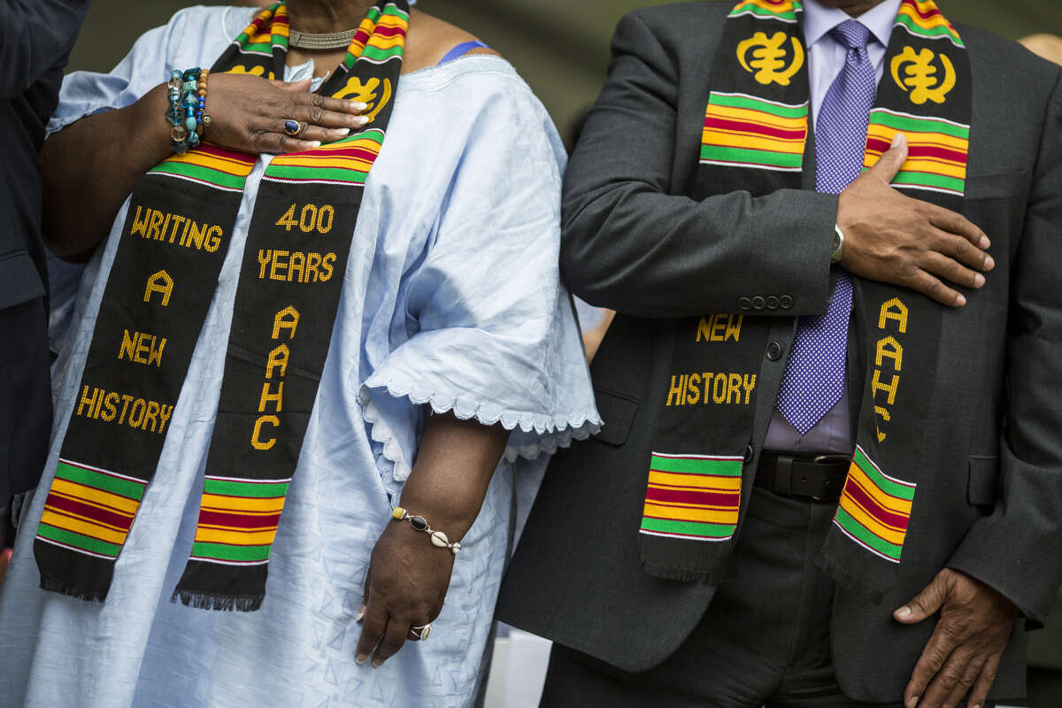 HAMPTON, VA - AUGUST 24: Members of the audience wear sashes during the 2019 African Landing Commemorative Ceremony on August 24, 2019 in Hampton, Virginia. The event marks the 400th arrival of the first African Slaves to English North America in 1619.