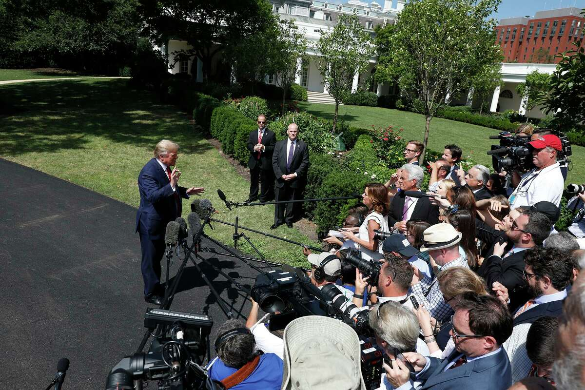 U.S. President Donald Trump talks to the media on the South Lawn of the White House in Washington, D.,C., before his departure to Louisville, Kentucky on Aug. 21.