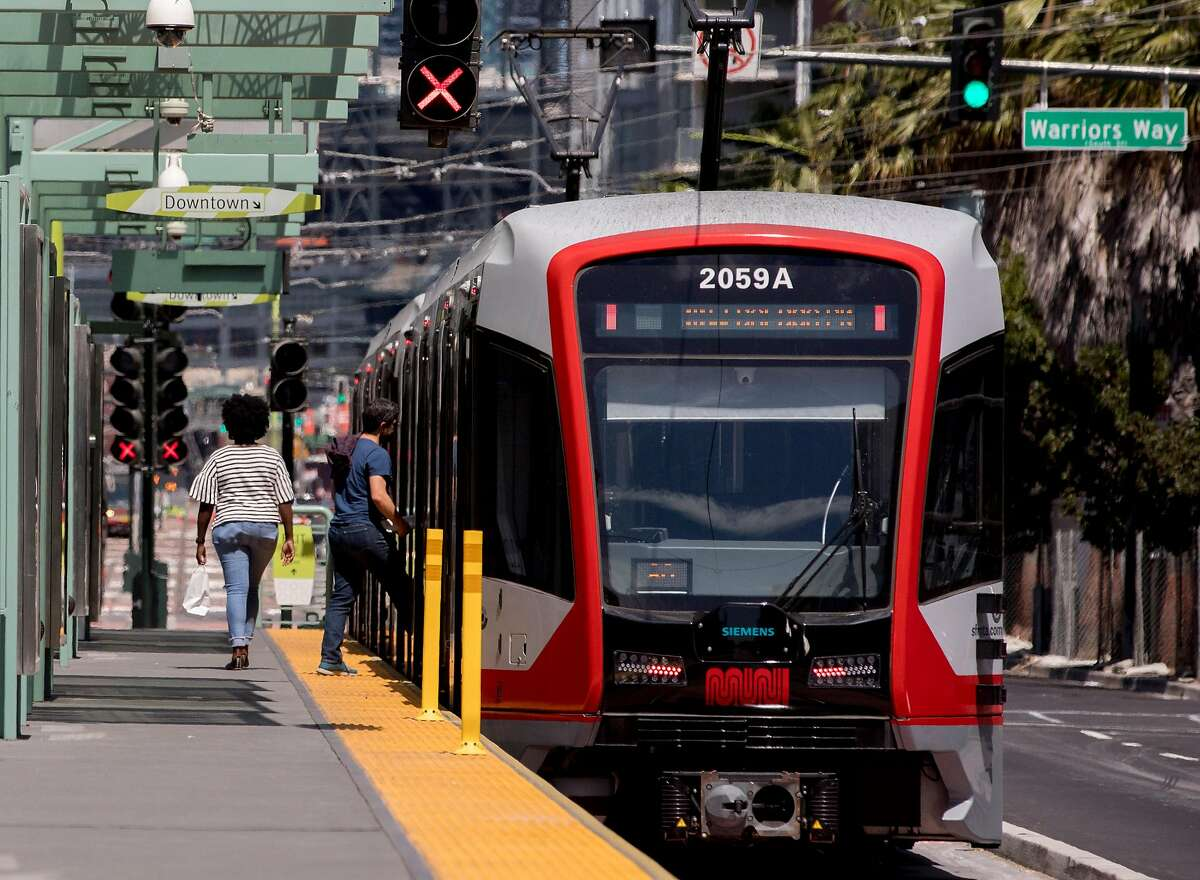 Riders board a T-Third Muni Metro train at the Chase Center Muni stop outside of the Chase Center in the Mission Bay neighborhood of San Francisco, Calif. Tuesday, August 27, 2019.