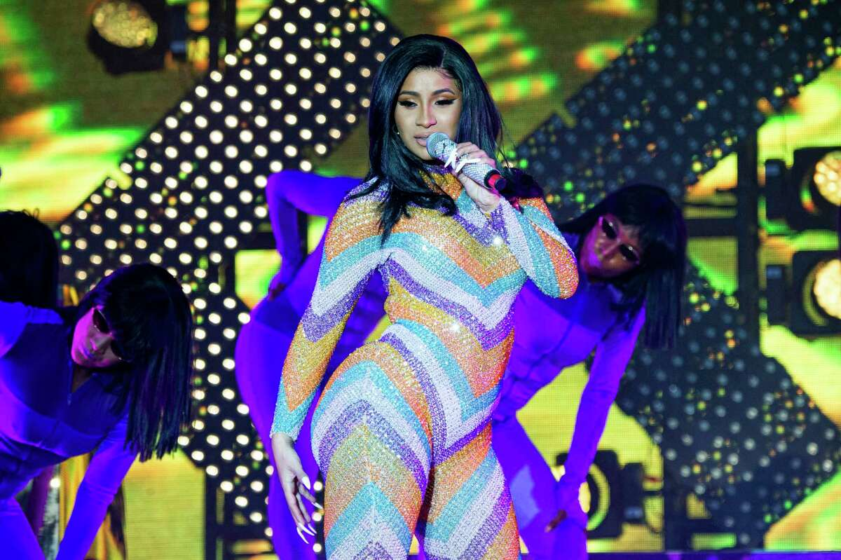 FILE - In this June 16, 2019 file photo, Cardi B performs at the Bonnaroo Music and Arts Festival in Manchester, Tenn. Cardi B postponed an Indianapolis concert following what police described as an unverified threat to the Grammy-winning artist. A post on her Twitter account offered an apology to fans about Tuesday, July 30 planned show at Bankers Life Fieldhouse, saying: