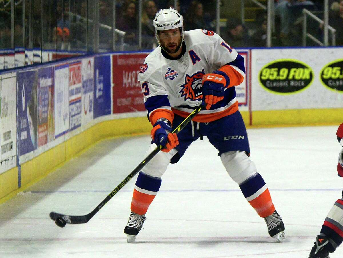 The Sound Tigers' Colin McDonald passes the puck against Hartford during a game in 2015 at the Webster Bank Arena in Bridgeport.