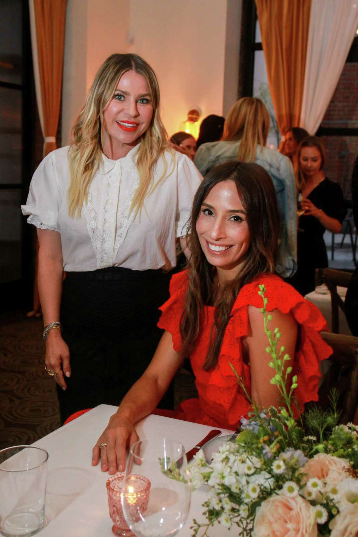 Emily Current, left, and Meritt Elliott at dinner at Indianola, where the designers unveiled their new collection for Pottery Barn. August 23, 2019.
