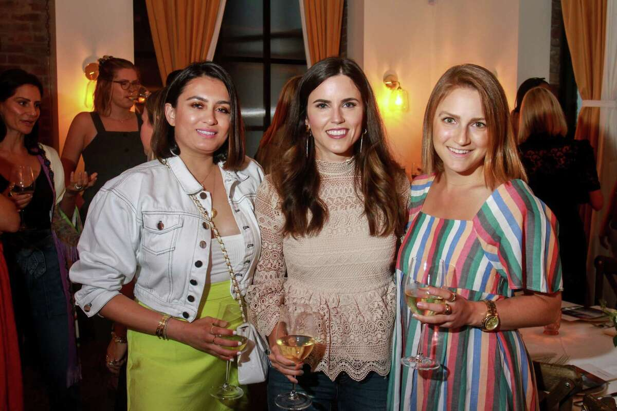 Sarah Adam, from left, Brittany Fullwood and Serena Famalette at dinner at Indianola, where former denim designers Emily Current and Meritt Elliott unveiled their new collection for Pottery Barn. August 23, 2019.
