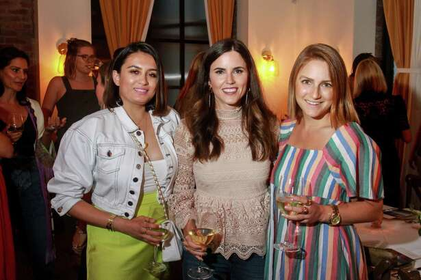 EMBARGOED FOR SOCIETY REPORTER UNTIL AUGUST 27 Sarah Adam, from left, Brittany Fullwood and Serena Famalette at dinner at Indianola, where former denim designers Emily Current and Meritt Elliott unveiled their new collection for Pottery Barn. August 23, 2019.