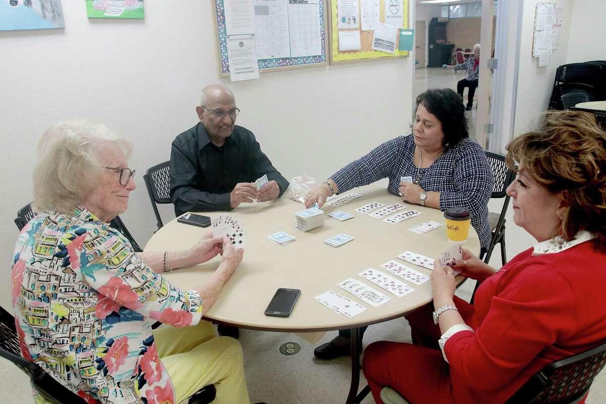 Heleene Sireci, left, Jaipal Chugh, Jenie Balderaz and Sandra Garcia enjoying a game of cards at the city of Friendswood's activity center.