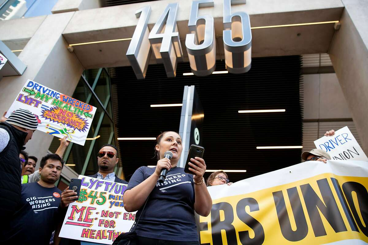 Annette Rivero, an organizer with Gig Workers Rising, gives a speech during a protest outside of Uber's Headquarters on Market Street in San Francisco, Calif. on Tuesday, August 27, 2019. Tuesday's protest is part of a three-day drive from Los Angeles to Sacramento to advocate for bill AB5 that would classify gig workers as employees.