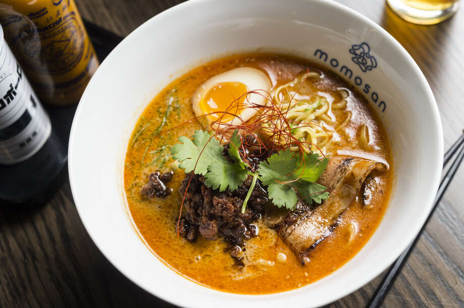 "Our next celebrity cuisine: ""Tantan Ramen,"" decked in spicy coconut curry, pork chashu, red miso, ground pork, aji-tama, and cilantro. Photo: Courtesy Of Morimoto Management"