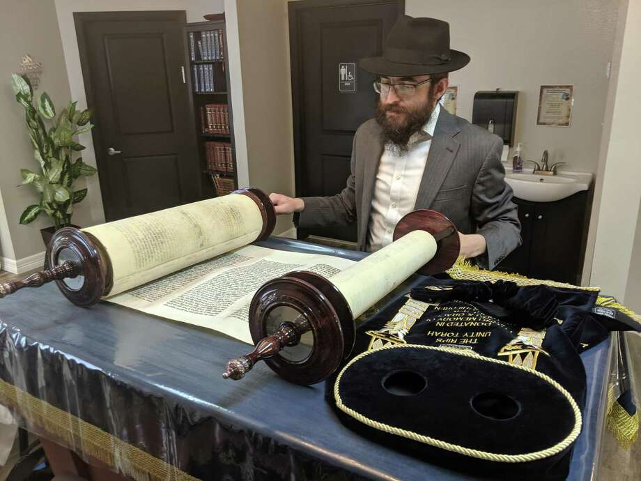 """It's raining Torahs!"" Rabbi Blecher said of obtaining three Torahs for his synagogue, Chabad of The Woodlands, in only eight years. Photo: Jamie Swinnerton"