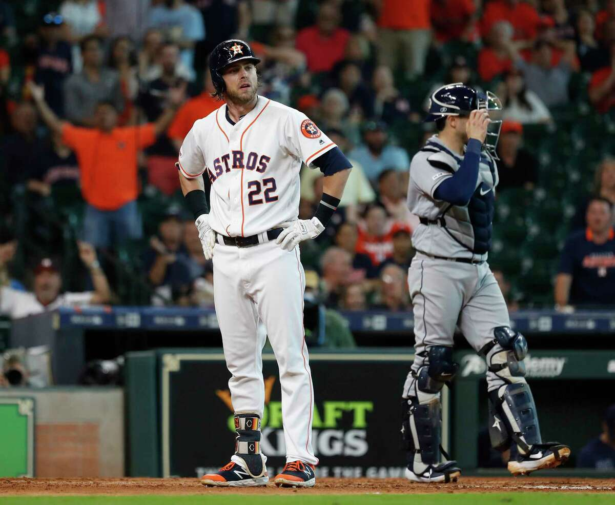 Houston Astros Josh Reddick (22) reacts after home plate umpire Jordan Baker, called him out on stikes, after thinking he had drawn a walk during the ninth inning of an MLB baseball game at Minute Maid Park, Thursday, August 29, 2019. Reddick was ejected.