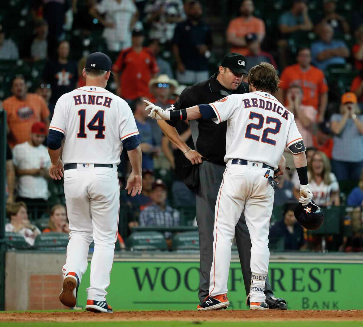 Houston Astros Josh Reddick (22) is ejected by home plate umpire Jordan Baker, after Reddick argued with him after Reddick thought he had drawn a walk, but was called out on stikes during the ninth inning of an MLB baseball game at Minute Maid Park, Thursday, August 29, 2019.
