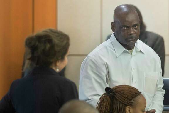 File photo shows former Houston Police Department narcotics officer Gerald Goines leaving a courtroom after appearing before Harris County Judge Frank Aguilar on Monday, Aug. 26, 2019, in Houston. Goines is charged with felony murder in deaths of Dennis Tuttle and Rhogena Nicholas Steve in a botched drug raid in January. He also is now facing federal charges arising from the incident.