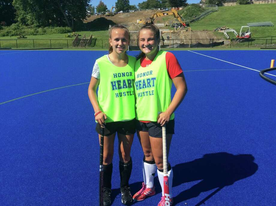 Sydney Gallop, left, and Morgan Smith are senior captains on the Sacred Heart Greenwich field hockey team. Photo: David Fierro /Hearst Connecticut Media