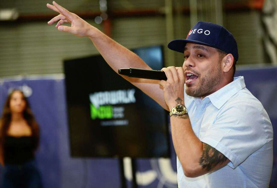 Norwalk artist Danny Evans performs his song, Norwalk Now, as Norwalk Now, the marketing site for the city's urban core, celebrates a relaunch Thursday, August 29, 2019, at Junction North Seven in Norwalk, Conn. The relaunch is a move to represent businesses city-wideand is also now be administered by the new office of economic and community development. Photo: Erik Trautmann / Hearst Connecticut Media / Norwalk Hour