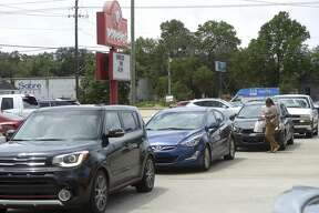 The drive-thru lane at Popeye's in Fort Walton Beach, Florida extended onto a main road on Friday Aug. 23, 2019 as most people were waiting to try the new chicken sandwich. People are choosing sides and beefing over chicken, thanks to Popeyes' release of its crispy chicken sandwich and the social media debate that has followed. With just one addition to a fast-food menu, the hierarchy of chicken sandwiches in America was rattled, and the supremacy of Chick-fil-A and others was threatened. (Nick Tomecek/Northwest Florida Daily News via AP)
