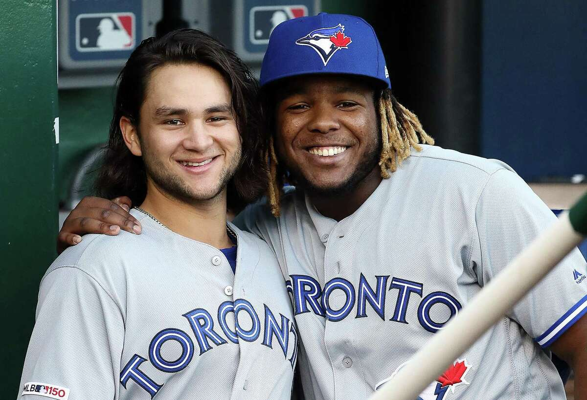 Although the Blue Jays have played only .400 ball this season, rookies Bo Bichette, left, and Vladimir Guerrero Jr. offer hope for the future.