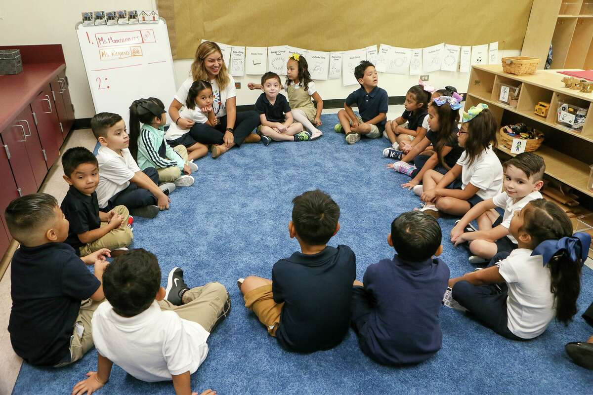 Students sit in a circle in Alyssa Manzanares' Kinder class on the first day of school at Gardendale Elementary School on Monday, Aug. 19, 2019. Edgewood ISD has partnered with the city's Pre-K 4 SA to turn the school into an early education center.