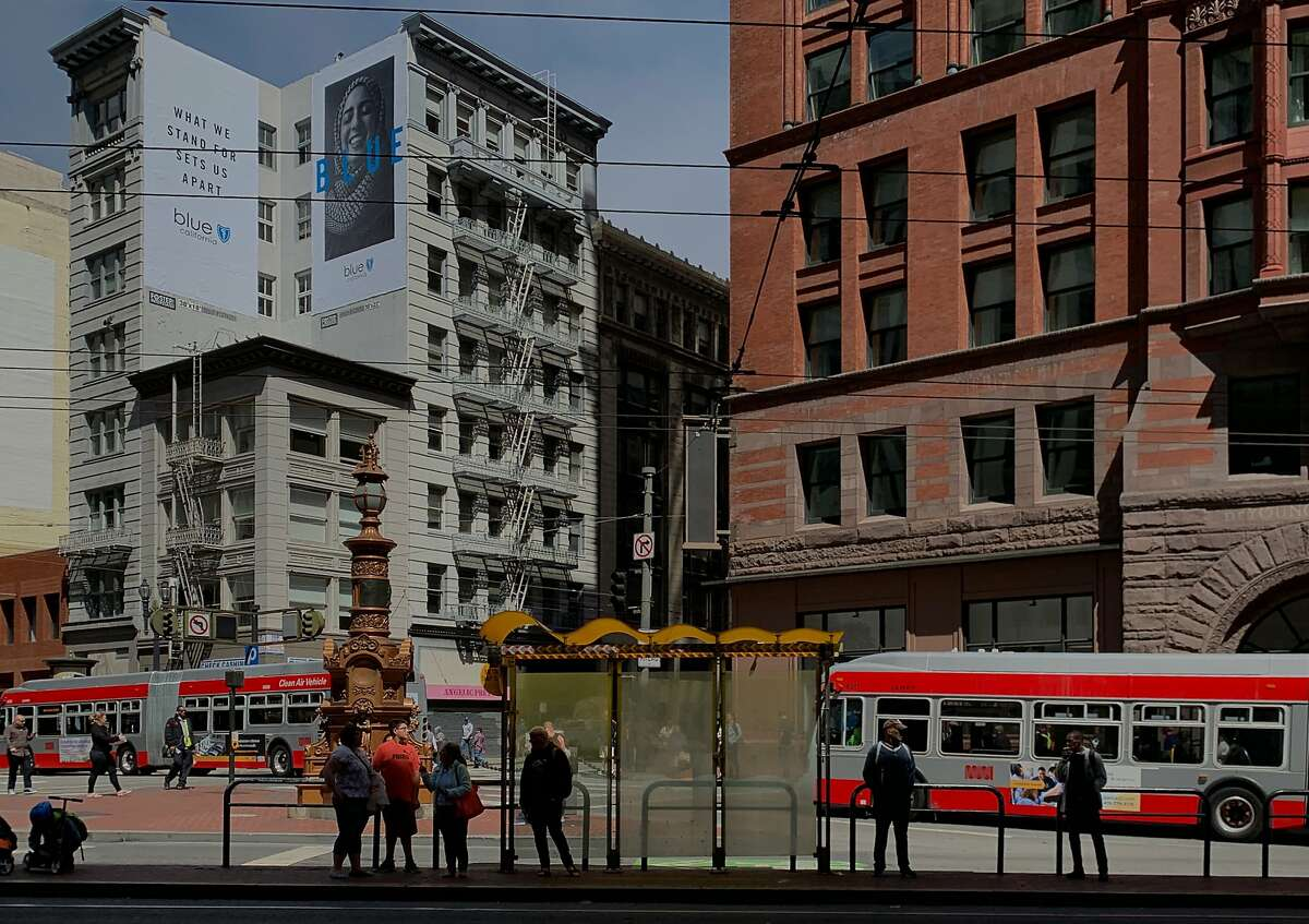 Riders wait for a train on the Muni platform at Market and New Montgomery streets in San Francisco, Calif. Thursday, July 23, 2019.